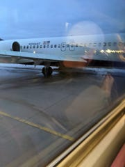 A plane slid off the taxiway at Austin Straubel International Airport Saturday morning.