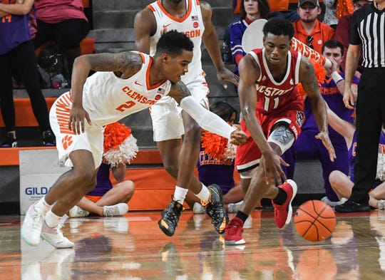 Clemson guard Al-Amir Dawes(2) reaches in for a ball near North Carolina State guard Markell Johnson during the second half at Littlejohn Coliseum Saturday, January 4, 2020.