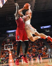 Clemson guard Curran Scott(10) shoots near North Carolina State forward D.J. Funderburk during the second half at Littlejohn Coliseum Saturday, January 4, 2020.