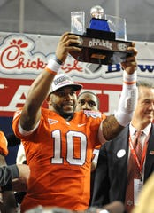 Clemson quarterback Tajh Boyd (10) holds the MVP trophy after the Tigers defeated LSU 25-24 Monday, December 31, 2012 in the Georgia Dome in Atlanta.