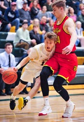 CMR's Bryce Nelson drives to the basket as Hellgate's Abe Johnson defends during Friday night's basketball game in the CMR Fieldhouse.