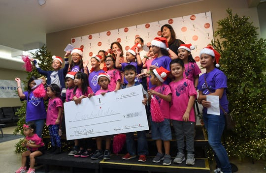"""B.P. Carbullido Elementary School receives a $500 check for """"Most Spirited"""" during the DFS Festival of Trees awards ceremony at T Galleria By DFS, Guam in Tumon Jan. 4, 2020."""