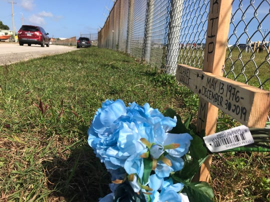 A cross and blue flowers were placed at the Tiyan scene of a Dec. 30, 2019 motorcycle accident, which killed motorcyclist Michael Usalla.