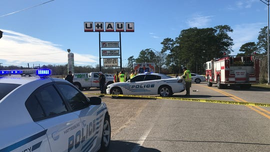 Hattiesburg police and firefighters respond to the scene where a body was found in the parking lot of a business on the U.S. 49 near Broadway Drive.