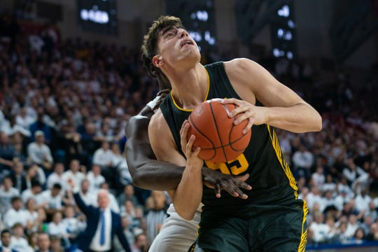Iowa center Luka Garza prepares to shoot the ball against Penn State during the first half Saturday at The Palestra in Philadelphia.