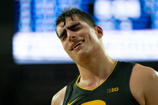 Iowa center Luka Garza, sweat pooling on his face, reacts after being called for a foul against Penn State during the second half at The Palestra on Saturday. Garza finished with 34 points and 12 rebounds in the Hawkeyes' 89-86 loss.