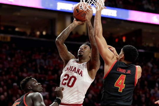 Indiana forward De'Ron Davis (20) goes up for a shot against Maryland forward Ricky Lindo Jr. (4) and center Chol Marial (15) during the first half of a NCAA college basketball game, Saturday, Jan. 4, 2020, in College Park, Md. (AP Photo/Julio Cortez)
