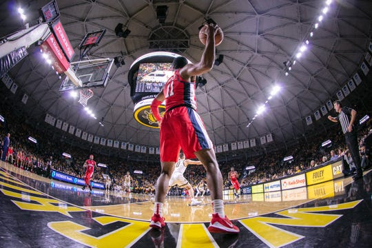 Jan 4, 2020; Wichita, Kansas, USA; Mississippi Rebels guard Franco Miller Jr. (11) inbounds the ball against the Wichita State Shockers during the first half at Charles Koch Arena. Mandatory Credit: William Purnell-USA TODAY Sports
