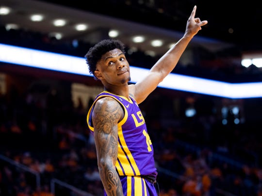 LSU guard Marlon Taylor (14) looks over to the Tennessee student section and points to the scoreboard during a basketball game between the Tennessee Volunteers and the LSU Tigers at Thompson-Boling Arena in Knoxville, Tenn., on Saturday, January 4, 2020.