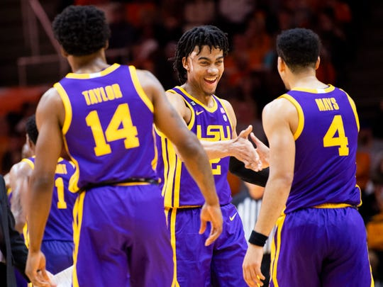 LSU forward Trendon Watford (2) high fives LSU guard Skylar Mays (4) during a basketball game between the Tennessee Volunteers and the LSU Tigers at Thompson-Boling Arena in Knoxville, Tenn., on Saturday, January 4, 2020.