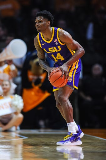 Jan 4, 2020; Knoxville, Tennessee, USA; LSU Tigers guard Marlon Taylor (14) looks to moves the ball during the first half against the Tennessee Volunteers at Thompson-Boling Arena. Mandatory Credit: Bryan Lynn-USA TODAY Sports