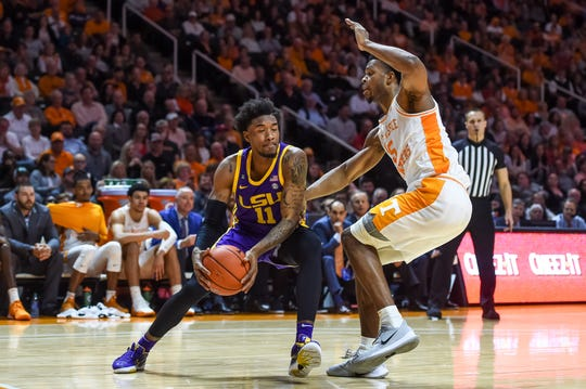 Jan 4, 2020; Knoxville, Tennessee, USA; LSU Tigers guard Charles Manning Jr. (11) is guarded by Tennessee Volunteers guard Josiah-Jordan James (5) during the first half at Thompson-Boling Arena. Mandatory Credit: Bryan Lynn-USA TODAY Sports