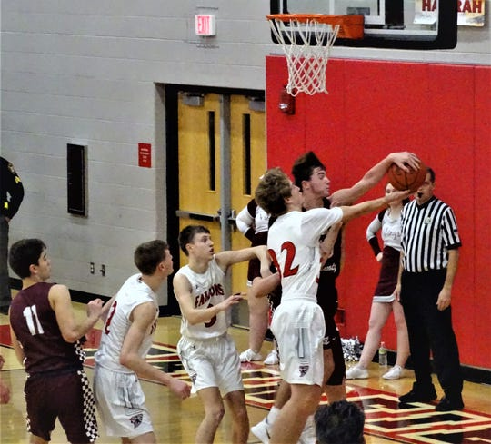 Fairfield Union's Andrew Moll fights for a rebound against Vinton County.
