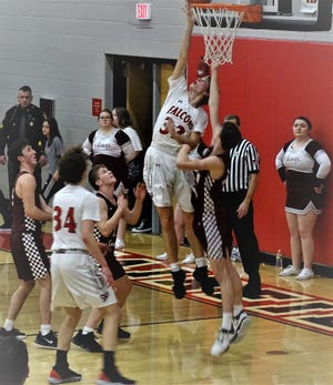 Fairfield Union's Andrew Moll lays in a shot against Vinton County during the Falcons' 55-38 non-conference win Friday night.