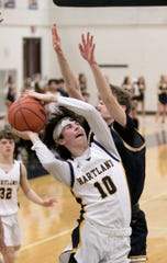 Hartland's Trevor Lewis goes into traffic to attempt a shot in a 43-35 victory over Walled Lake Central on Friday, Jan. 3, 2020.