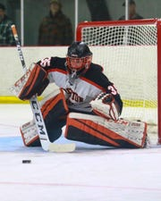 Chris Wozniak made 33 saves for Brighton in a 3-2 victory over Houghton.