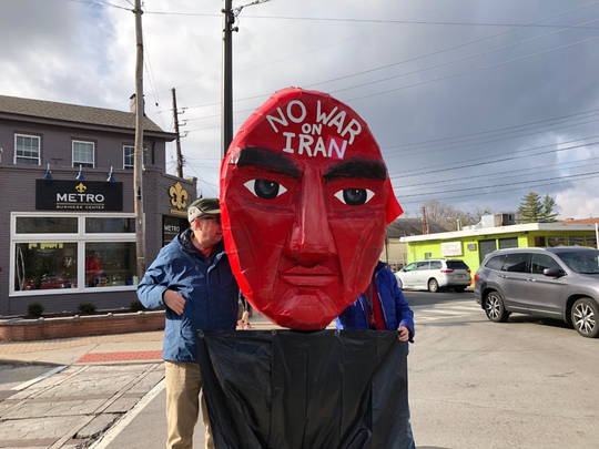 Protesters gathered Saturday, Jan. 4, 2020, at Bardstown Road and Douglass Boulevard to voice their concerns about the Pentagon's airstrike that killed Iranian Gen. Qasem Soleimani and to demand the withdrawal of American troops from the Middle East.
