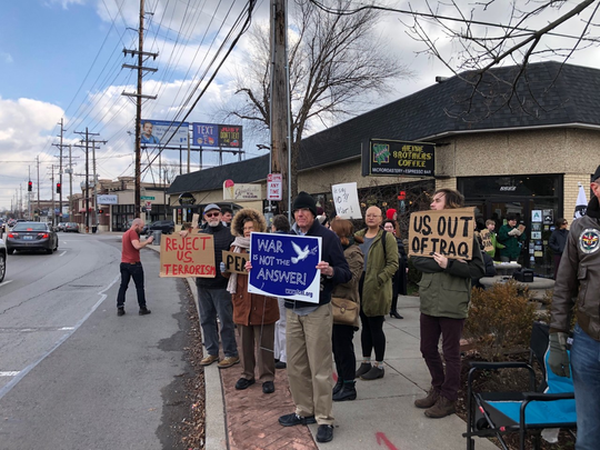 Protesters gathered Saturday at Bardstown Road and Douglass Boulevard to voice their concerns about the Pentagon's airstrike that killed Iranian Gen. Qasem Soleimani and to demand the withdrawal of American troops from the Middle East.