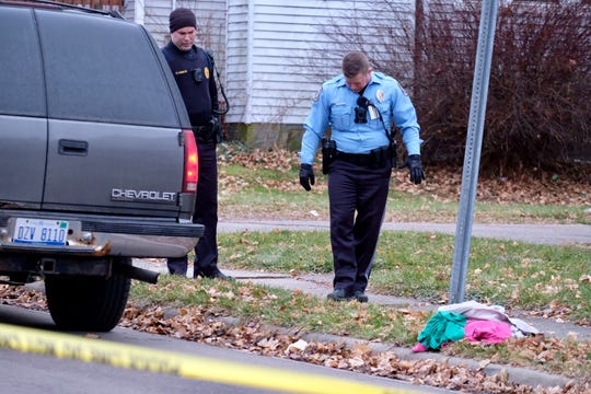 Lansing police look for evidence at a crime scene near the corner of Mt. Hope and Donora Saturday, Jan. 4, 2020.