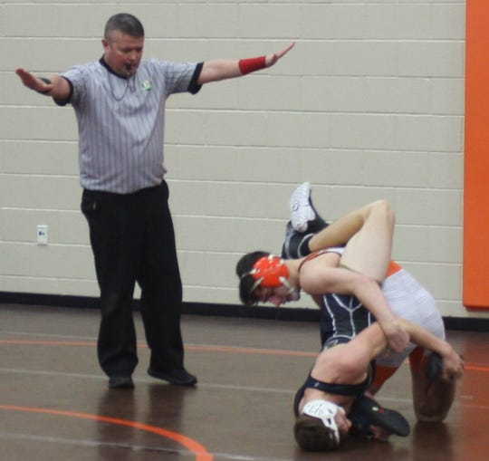 Mansfield Senior's Josh Lyons works for a pin but settles for a 13-2 win over Black River's Orellano at 132 pounds in the second round of the 58th J.C. Gorman Invitational.