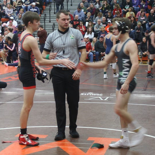 Crestview's state-ranked freshman Hayden Kuhn (left) shakes hands with Madison's Ted Haring after Kuhn wins by pin in the second round en route to qualifying for the semifinals in the 58th J.C. Gorman Invitational.