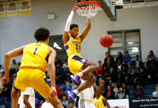 Montverde Academy's Zeb Jackson dunks the ball against Olive Branch during the ARS National Hoopfest at Olive Branch High School on Friday, Jan. 3, 2020.