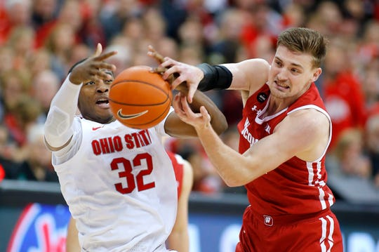 Wisconsin forward Micah Potter battles Ohio State forward E.J. Liddell for a rebound with during the second half.