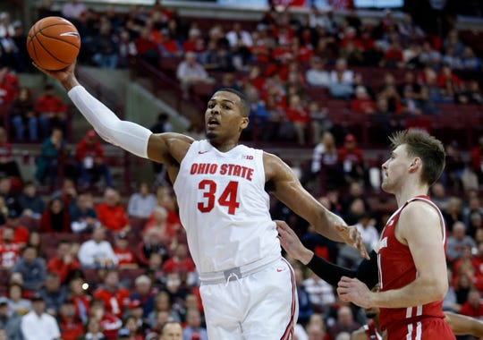 Ohio State forward Kaleb Wesson grabs a rebound in front of Wisconsin forward Micah Potter during the first half.