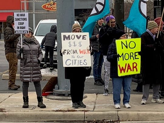 Anti-war protesters gather at the intersection of South 27th Street and West Oklahoma Avenue on Saturday. The demonstration was one of more than 70 staged across the country to condemn the U.S. killing of Iranian Maj. Gen. Qasem Soleimani and the decision to send additional troops to the Middle East.