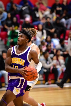 Forward Nick Traylor filled up the box score for Wossman, dropping 30 points on Zachary and pulling down 10 rebounds on the semifinals of the Don Redden Memorial Classic on Friday at the Madhouse on Millhaven.