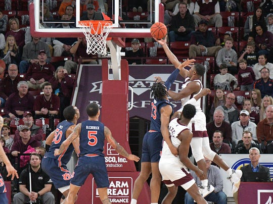Jan 4, 2020; Starkville, Mississippi, USA; Mississippi State Bulldogs guard Iverson Molinar (5) shoots against Auburn Tigers forward Isaac Okoro (23) during the first half at Humphrey Coliseum. Mandatory Credit: Jim Brown-USA TODAY Sports