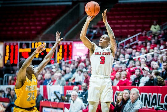 Ball State's Josh Thompson shoots a three pointer past Toledo's defense during their game at Worthen Arena Friday, Jan. 3, 2020.