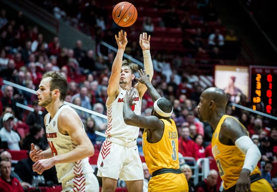 Ball State's Luke Bumbalough shoots past Toledo's defense during their game at Worthen Arena Friday, Jan. 3, 2020.