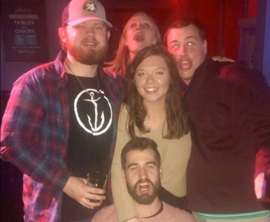 Colin Reno, 22, was killed in a car accident after the driver of another vehicle ran a red light while trying to avoid gunfire, Nashville police said. He's pictured, left, with a friends including a teammate from the Belmont Abbey College golf team, Brody Davis, far right.