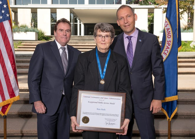 Reta Beebe, NMSU astronomy professor emerita, stands with Michael Watkins, director of NASA's Jet Propulsion Laboratory in Pasadena, California (left), and Thomas Zurbuchen, associate administrator of NASA's Science Mission Directorate in Washington after receiving the 2019 NASA Exceptional Public Service medal for the second time.