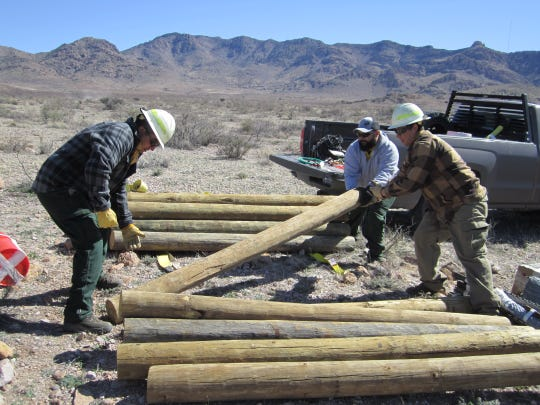 Bureau of Land Management wildlife biologists, fire and operation staff do some heavy lifting to build wildlife waters in a remote area of public land.