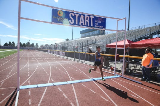 Brandon Joe wins first place in the half marathon at the 'Las Cruces Half' event starting and ending at the Field of Dreams in Las Cruces on Saturday, Jan. 4, 2019.