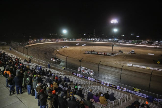 Spectators watch the race at the World of Outlaws race at Vado Speedway Park in Vado on Friday, Jan. 3, 2020.