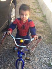 Recardo Soto's son, Jeremiah Nevarez rode his bicycle dressed as Spiderman.