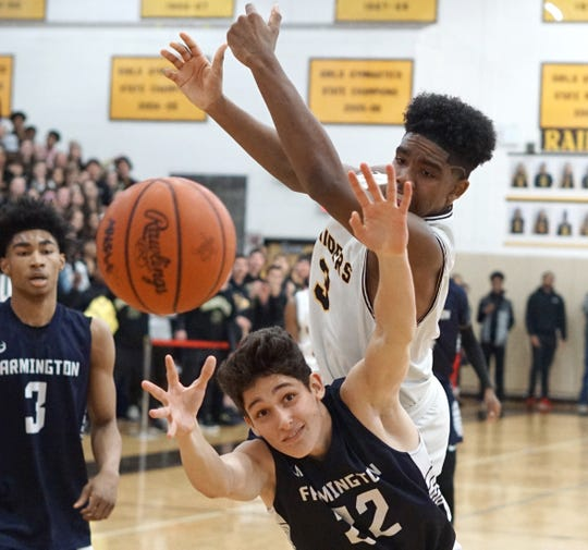North Farmington's Eddie Lenton III, top, Farmington's Siddiq Abulmajeeed and a potential rebound all go flying at the same time.
