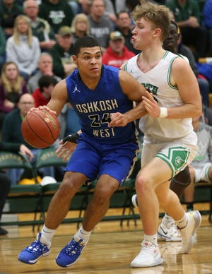 Oshkosh West's Karter Thomas (24) drives past Oshkosh North's Ethan Tessmer during a Jan. 3 game in Oshkosh.