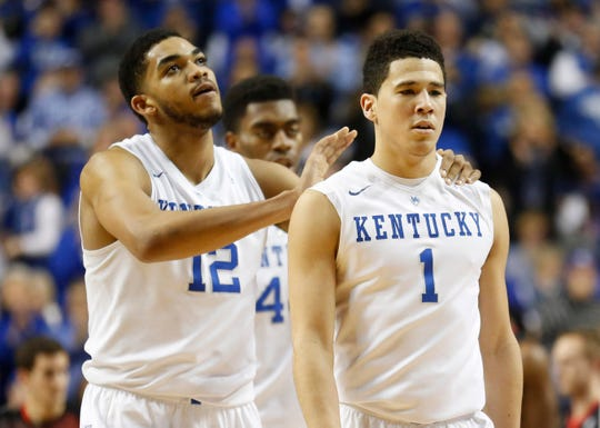 Karl-Anthony Towns (12) and Devin Booker (1) were teammates at Kentucky for a season. Could they be teammates in the NBA?