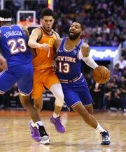 Phoenix Suns guard Devin Booker (1) pressures New York Knicks forward Marcus Morris Sr. (13) in the second half at Talking Stick Resort Arena on Jan. 3, 2020 in Phoenix, Ariz.