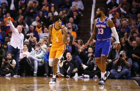 Phoenix Suns forward Kelly Oubre Jr. (3) reacts after making a 3-pointer against New York Knicks forward Marcus Morris Sr. (13) in the second half at Talking Stick Resort Arena on Jan. 3, 2020 in Phoenix, Ariz.