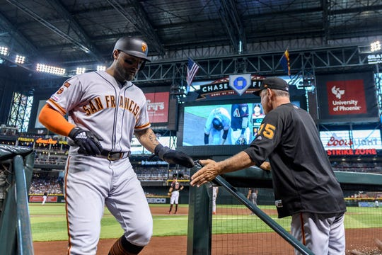San Francisco Giants center fielder Kevin Pillar (1) is congratulated by manager Bruce Bochy (15) after scoring against the Arizona Diamondbacks in the third inning at Chase Field. Could Pillar be on the Diamondbacks in 2020?
