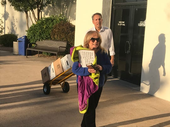 Janet Wilson, chair for the Committee to Protect Old Town Scottsdale, and former City Councilman David Ortega drop off signatures for a referendum that would send the Southbridge II project to a vote.