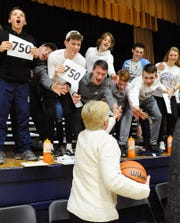 Lebanon Catholic students congratulate Patti Hower on her 750th career victory as girls basketball coach on Friday night.