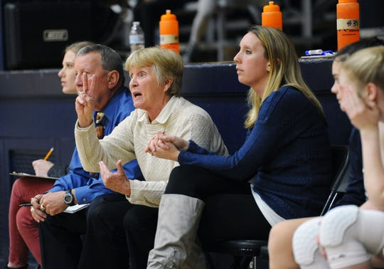 Lebanon Catholic head coach Patti Hower shouts out instructions to her team as assistants Mike Mohl, left, and Becky Hower Kleinfelter, look on