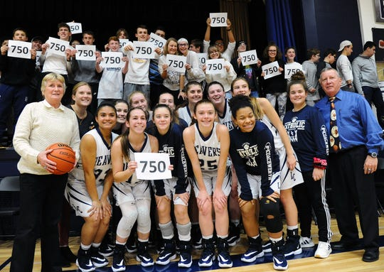 Patti Hower, front row left, celebrates her 750th career head coaching victory at Lebanon Catholic with her team, students and longtime assistant coach Mike Mohl (far right).