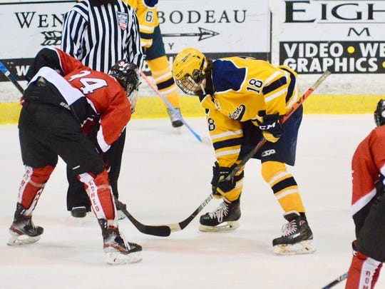 Logan O'Flanagan takes a faceoff against Romeo during a hockey game on Saturday, Jan. 4, 2020, at McMorran Place in Port Huron.